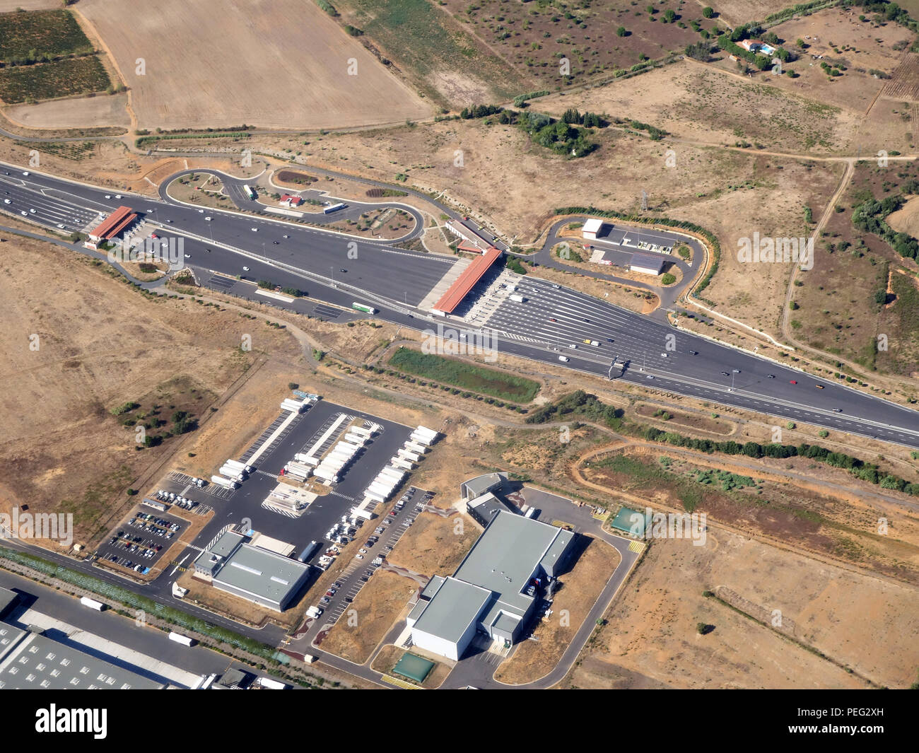 Aerial photograph of the Autoroute toll booths on the A75 La Méridienne, 34420 Béziers, France - Stock Image