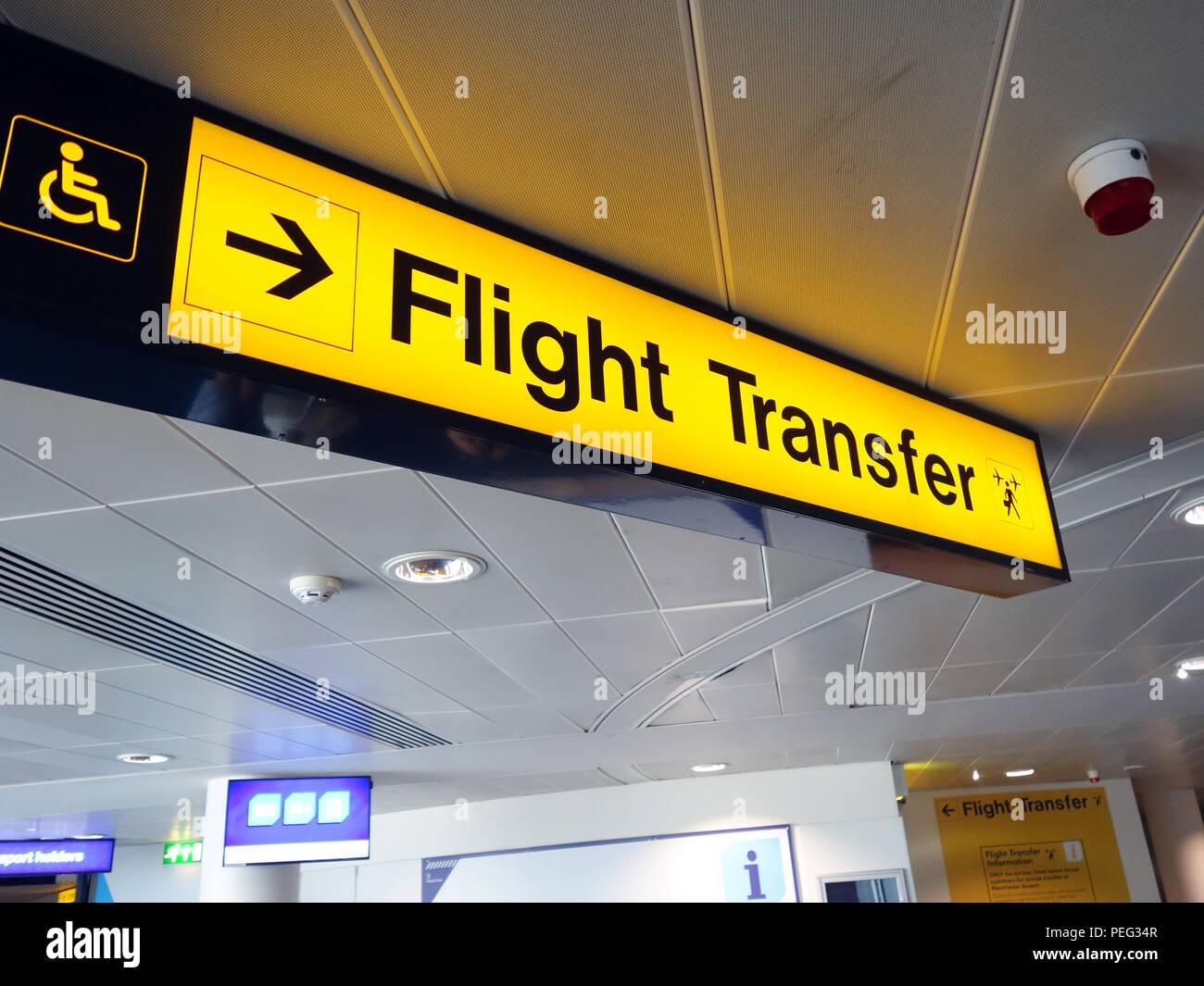 Illuminated Flight Transfer direction sign at Manchester International Airport Stock Photo