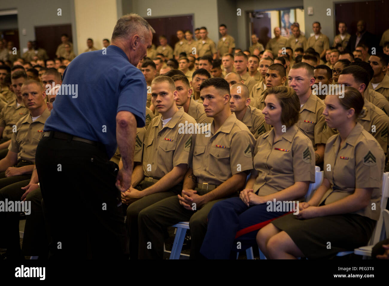 Retired U.S. Marine Corps Lt. Col. Jake Matthews, guest speaker, delivers a speech to Marines of 2nd Marine Aircraft Wing and Marine Corps Air Station (MCAS) Cherry Point during a 2nd Marine Expeditionary Force, Force Preservation Campaign, 'Protect what you've earned' brief at MCAS Cherry Point, N.C., on Aug. 21, 2015. The purpose of the campaign is to promote and inculcate a culture of making responsible decision to help ensure our Marines and Sailors protect what they have earned as service members by avoiding destructive behavior that places them at great personal and professional risk. (U - Stock Image