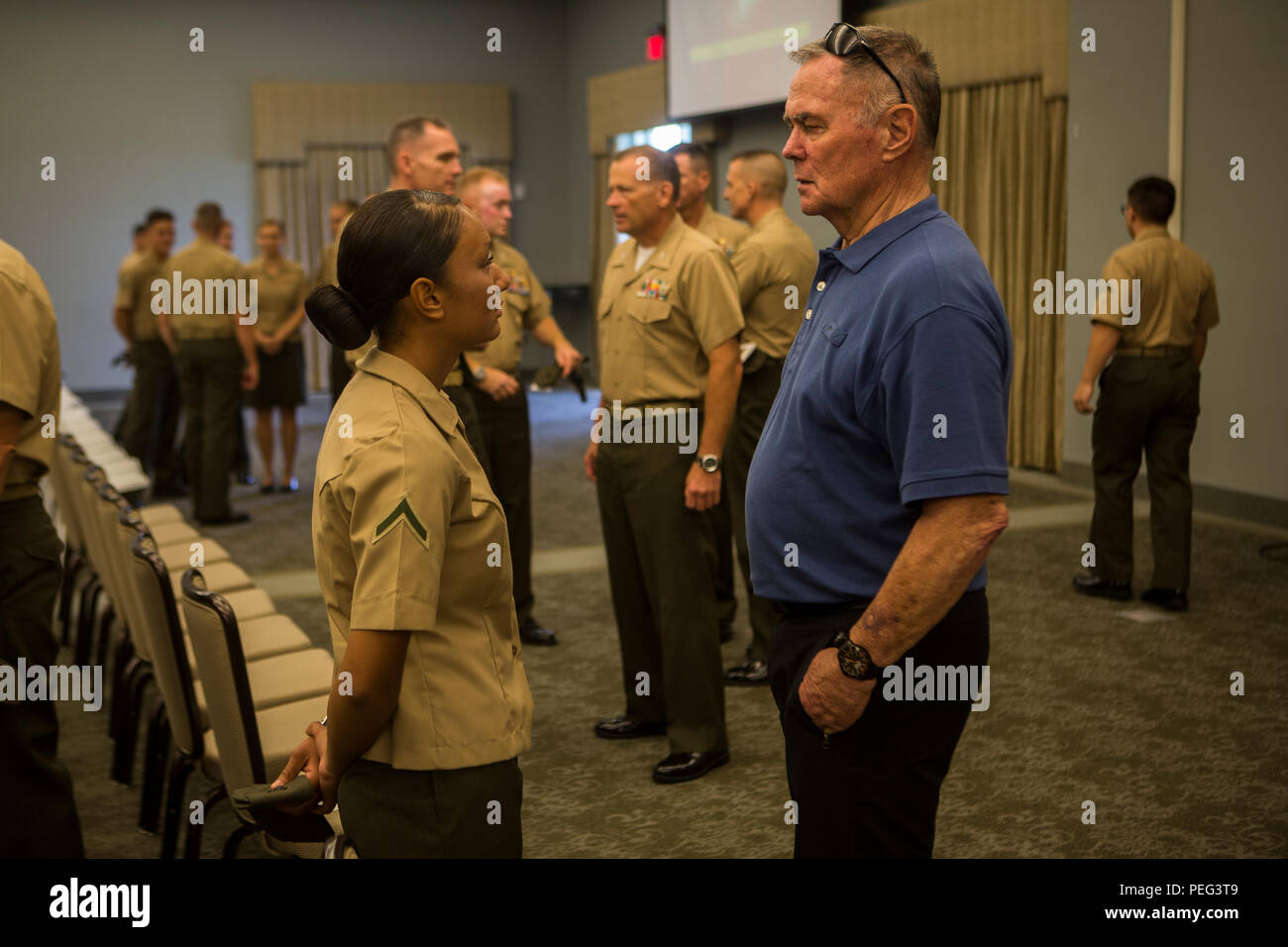 Retired U.S. Marine Corps Lt. Col. Jake Matthews, guest speaker, receives comments and answers questions after a 2nd Marine Expeditionary Force, Force Preservation Campaign, 'Protect what you've earned' brief at Marine Corps Air Station Cherry Point, N.C., on Aug. 21, 2015. The purpose of the campaign is to promote and inculcate a culture of making responsible decision to help ensure our Marines and Sailors protect what they have earned as service members by avoiding destructive behavior that places them at great personal and professional risk. (U.S. Marine Corps photo by Pfc. Jered T. Stone/R - Stock Image