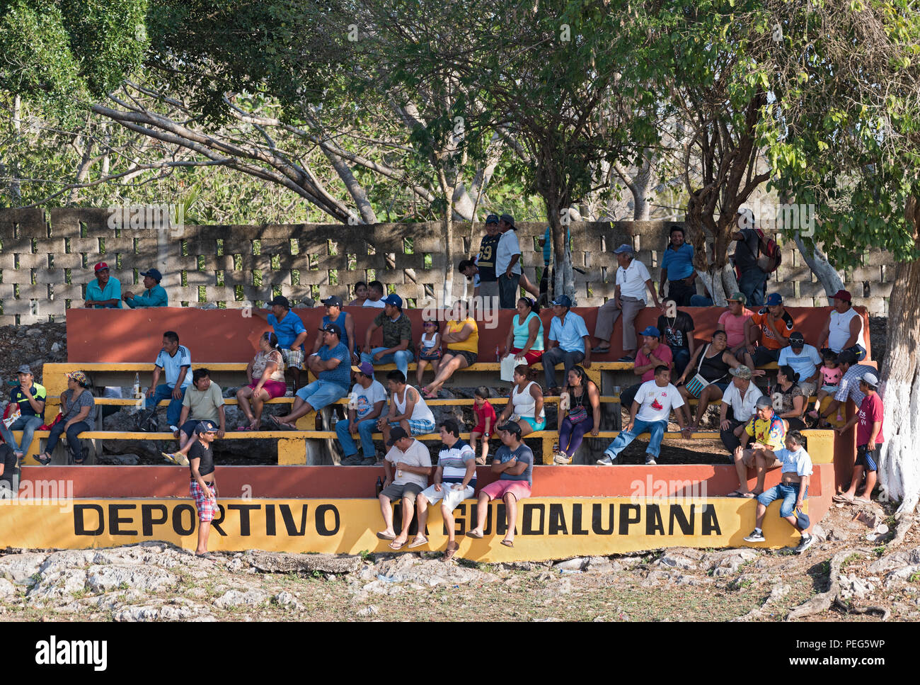 Spectators of a baseball game in the piste, Yucatán, Mexico. - Stock Image
