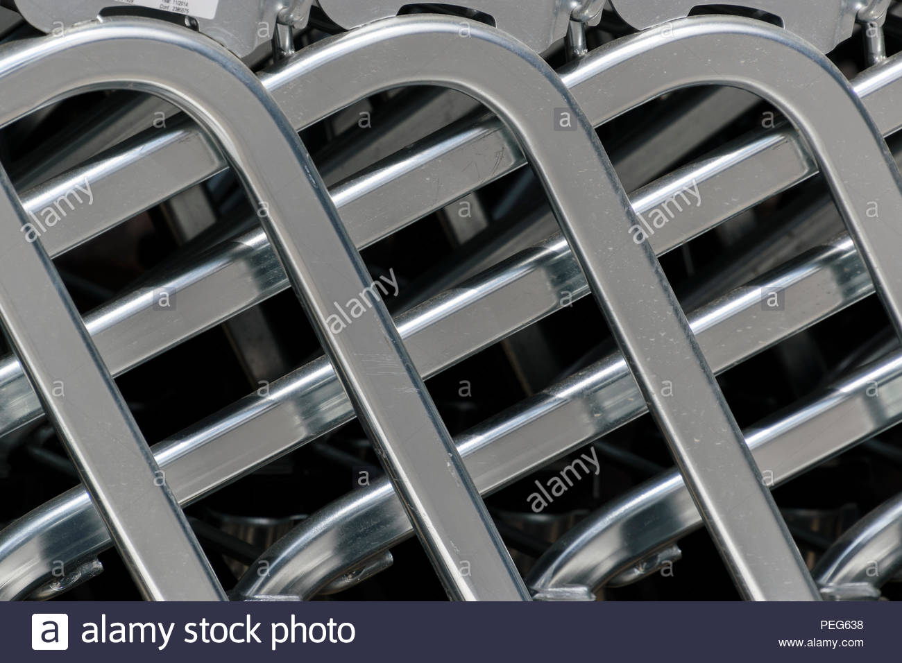Close up image of several shopping trolleys pushed together forming an abstract, Oxfordshire, England, UK - Stock Image