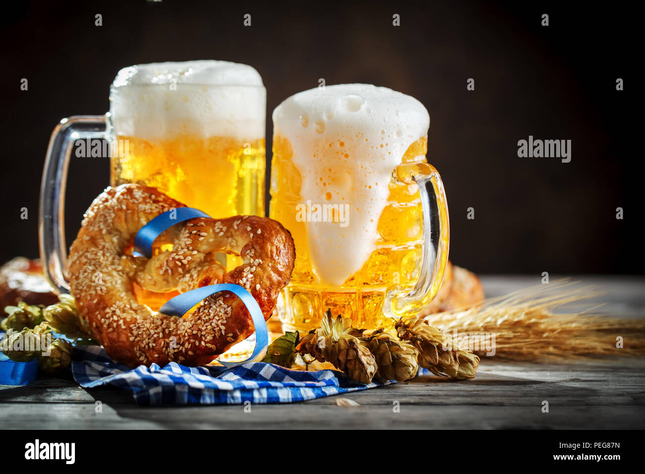 Beer mugs and pretzels on a wooden