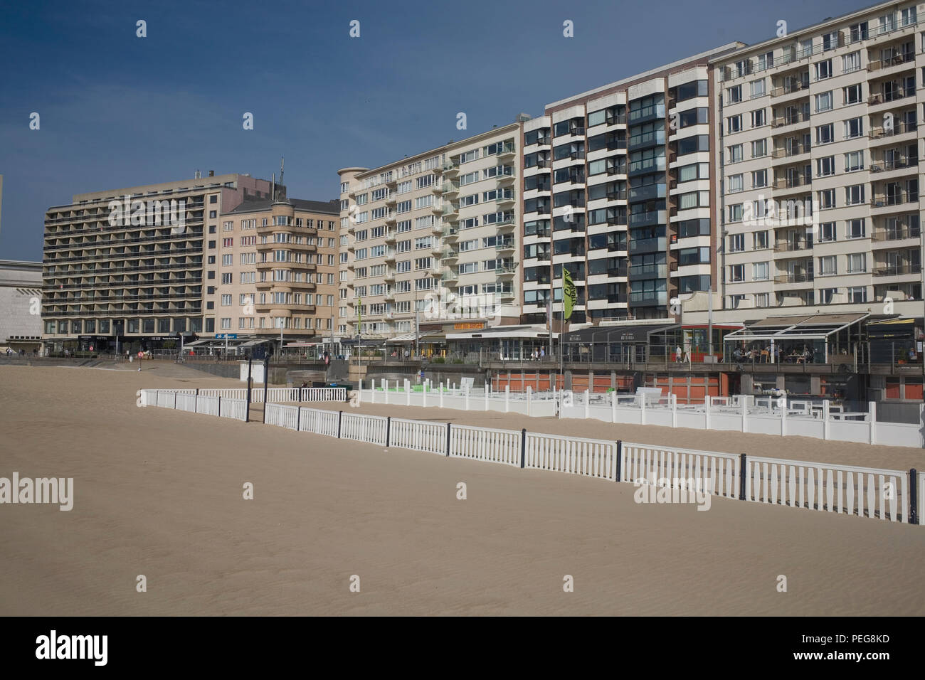 Seafront by Albert I promenade with fenced section of beach - Stock Image