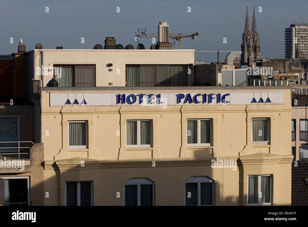 Top of Hotel Pacific seen from balcony of top floor room of a nearby hotel - Stock Image
