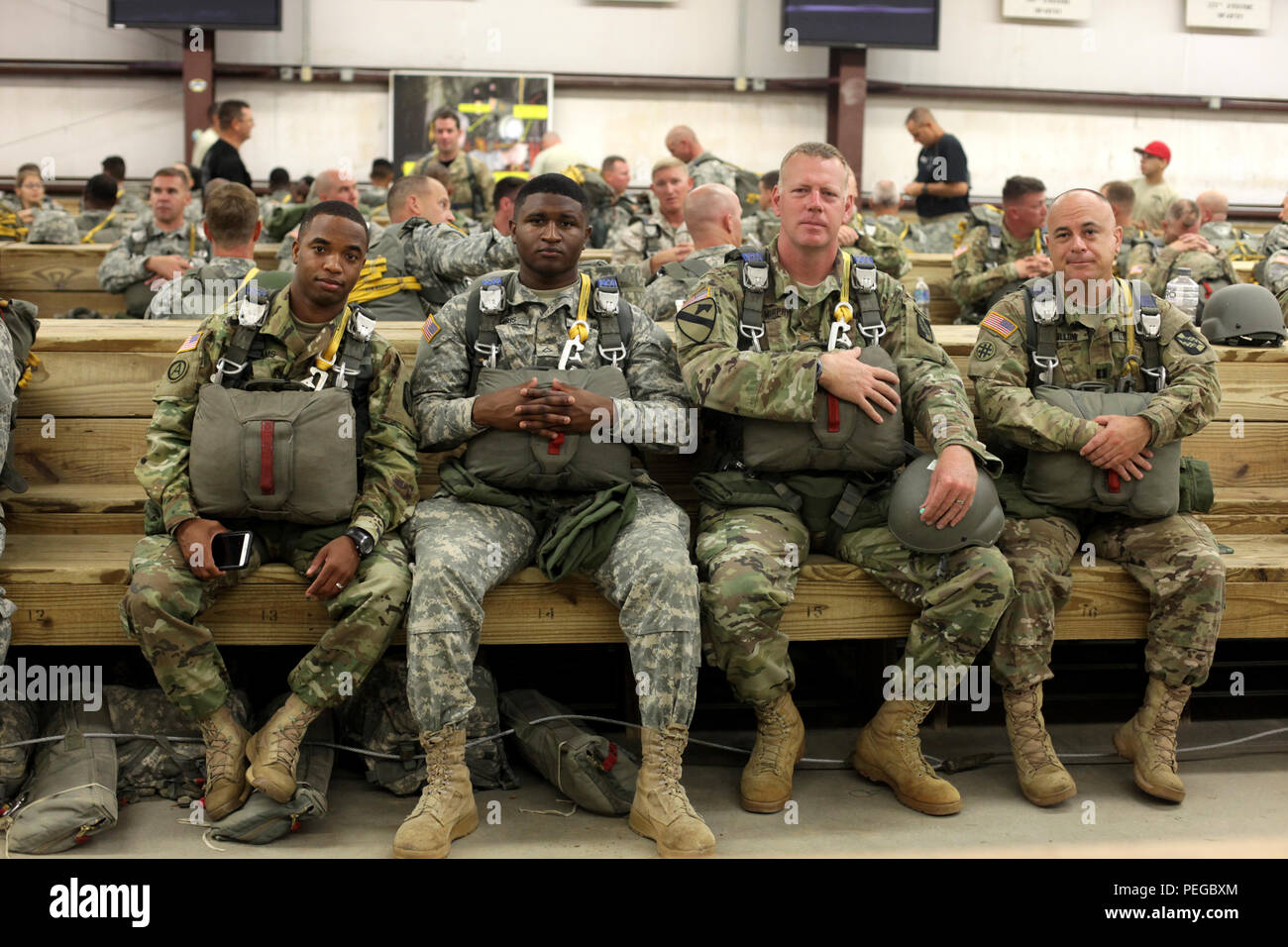 f9506c67b0d03 U.S Army paratroopers from the 982nd Combat Camera Company wait to  participate in a jump commemorating