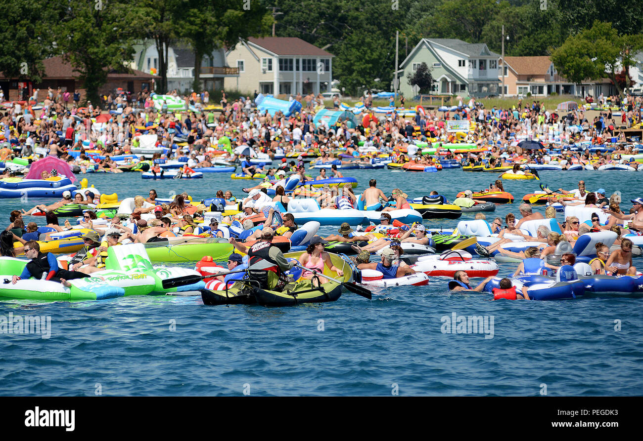 More than 1,000 people participated in the unsanctioned marine event known as the Port Huron Float Down Aug. 16, 2015, during which participants gathered at Lighthouse Beach in Port Huron, Mich., to float 7.5 miles down the St. Clair River on the border of the U.S. and Canada in inflatable and makeshift rafts. The event has no official organizer and poses significant and unusual hazards given the fast-moving current, large number of participants, lack of life jackets, alcohol consumption, potentially challenging weather conditions, water temperature and limited rescue resources. (U.S. Coast Gu - Stock Image
