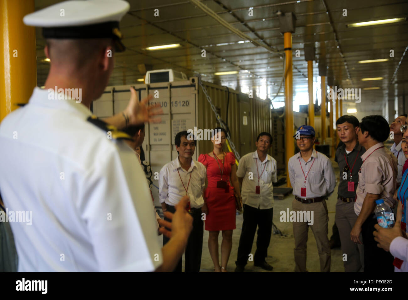 150818-M-GO800-008 DA NANG, Vietnam (August 18, 2015) – Lt. j.g. Mark Roach explains to local Vietnamese officials the function of the mission bay aboard the Military Sealift Command joint high speed vessel USNS Millinocket (JHSV 3) during a ship tour Aug. 18. Task Force Forager, embarked aboard the Millinocket  is serving as the secondary platform for Pacific Partnership, led by an expeditionary command element from the Navy's 30th Naval Construction Regiment (30 NCR) from Port Hueneme, Calif. Now in its 10th iteration, Pacific Partnership is the largest annual multilateral humanitarian assis - Stock Image