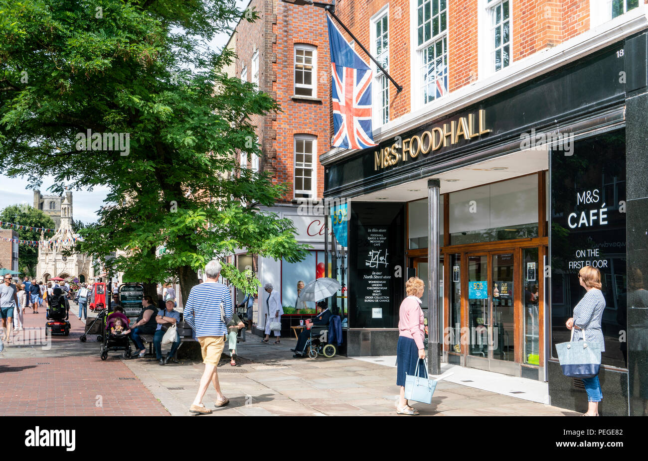 Marks & Spencer Food Hall, mens' fashion store and café in East Street, Chichester, West Sussex, a classic British high street business. - Stock Image