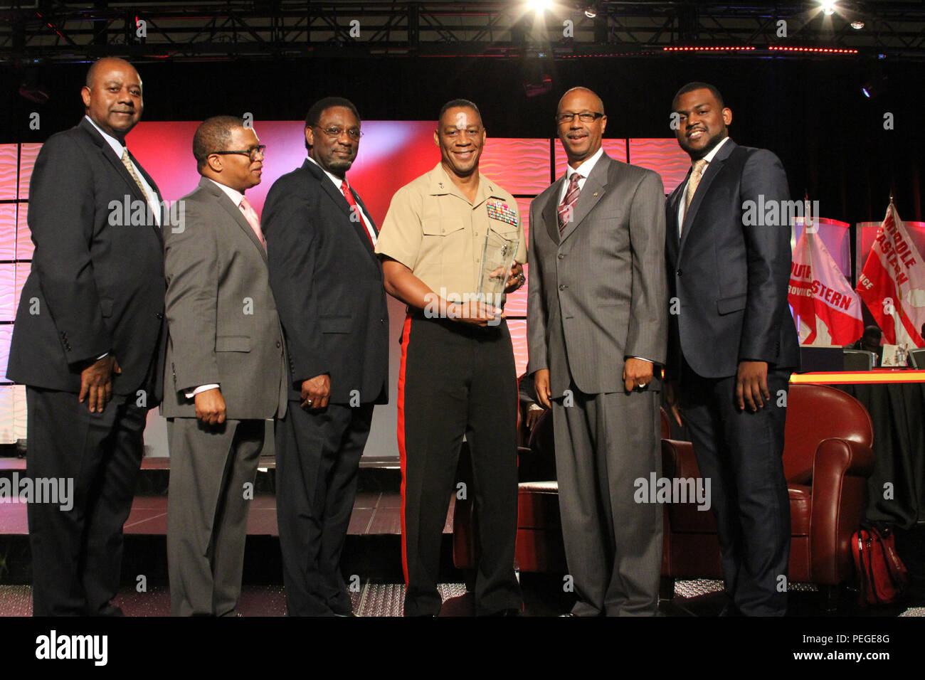 Maj. Gen. Craig Crenshaw, Headquarters Marine Corps assistant deputy commandant for installations and logistics, receives the Kappa Alpha Psi Fraternity Partner Appreciation Award during the Kappa Alpha Psi Fraternity, Inc., 82nd Grand Chapter Meeting held in New Orleans, Aug. 13, 2015. Crenshaw, who is also a member of the fraternity, attended the Grand Chapter Meeting to celebrate its 104th year of service by men of achievement. (U.S. Marine Corps photo by Sgt. Rubin J. Tan) - Stock Image