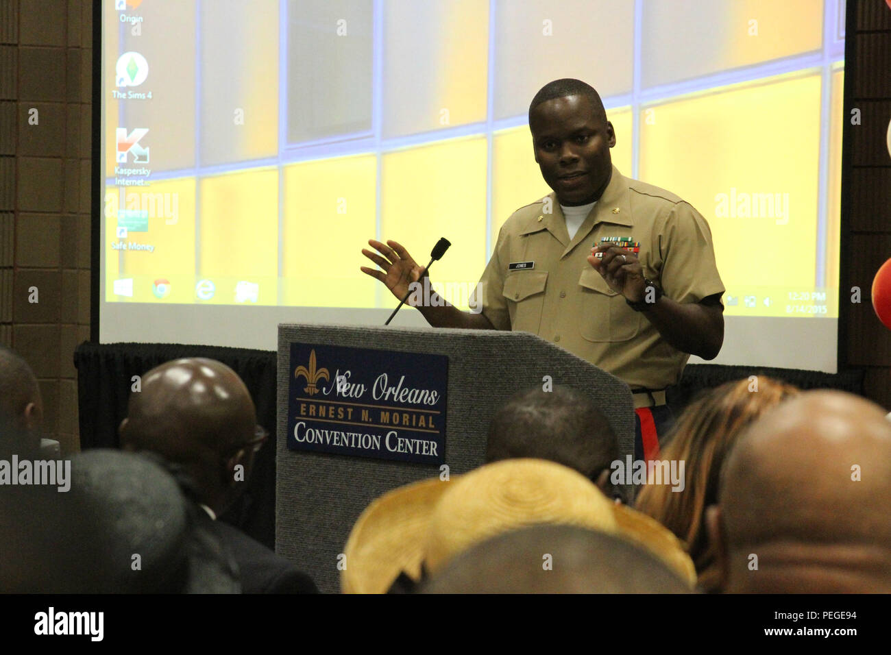 Maj. Tito Jones, Marine Corps Base Camp Smedley D. Butler, Okinawa, deputy provost marshal, speaks during the undergraduate Student of the Year Scholarship Program held by the Kappa Alpha Psi Fraternity, Inc., for their 82nd Grand Chapter Meeting held in New Orleans, Aug. 14, 2015. Thousands of undergraduate youth descended on New Orleans to participate in the annual Grand Chapter Meeting and had an opportunity to meet and interact with Marines who are members of the fraternity. (U.S. Marine Corps photo by Sgt. Rubin J. Tan) - Stock Image