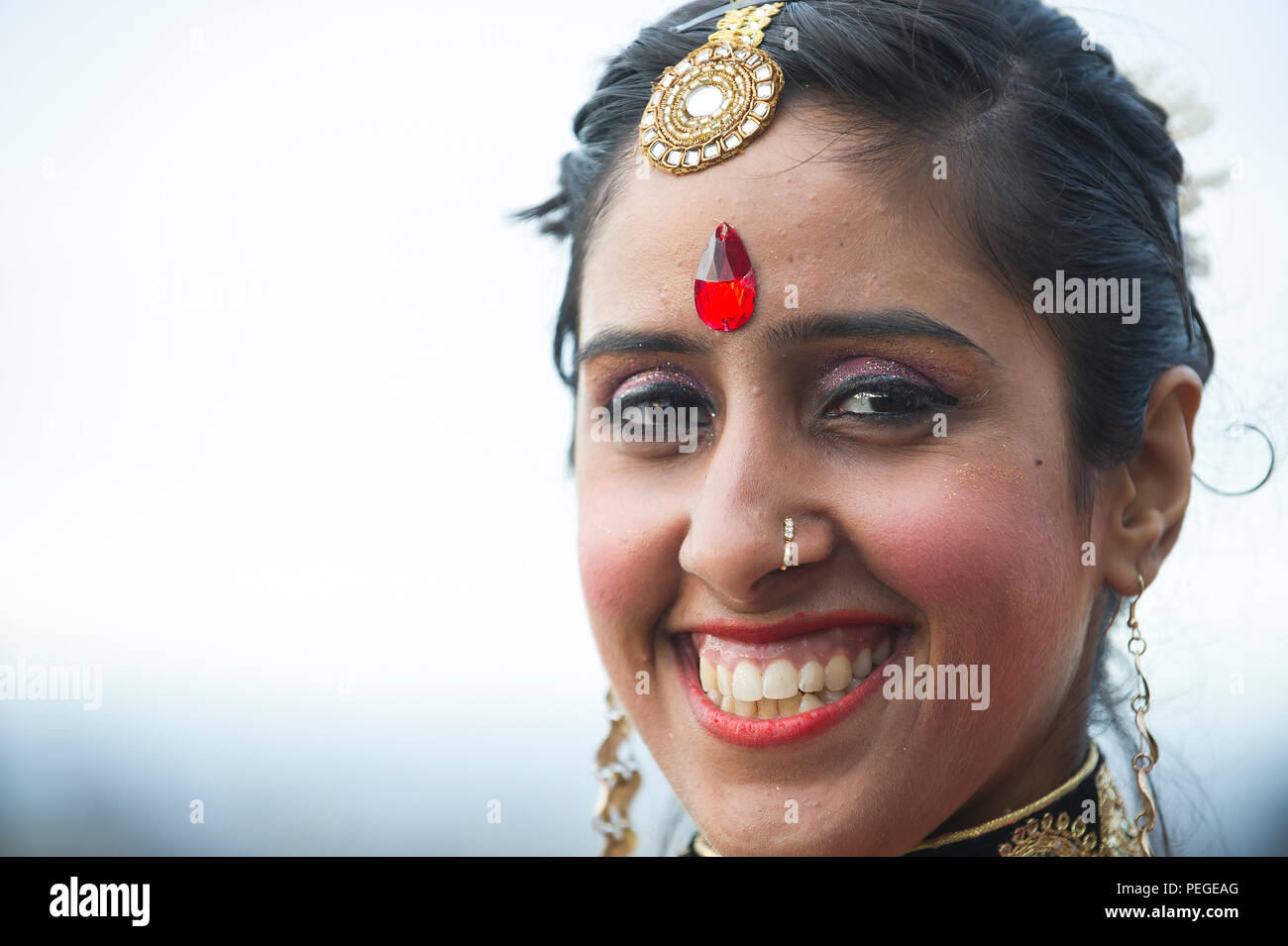 A Bollywood Dancer Poses For A Photo Before Performing During The