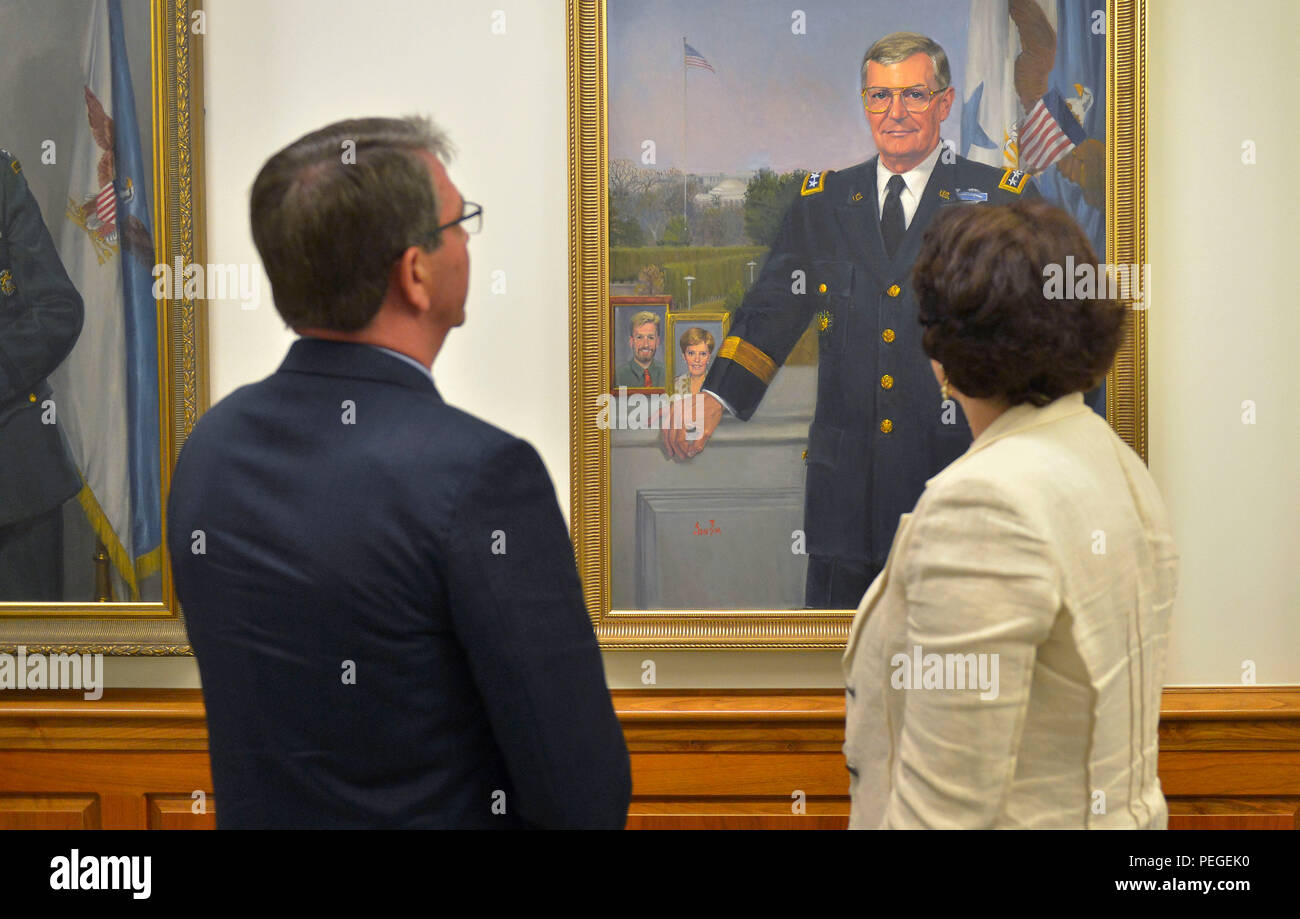 Secretary of Defense Ash Carter shows the official portrait of former Chairman of the Joint Chiefs of Staff Army Gen. John Shalikashvili as he welcomes the Minister of Defense of Georgia Tinatin Khidasheli to the Pentagon, Aug. 18, 2015. Born in Warsaw, Poland, to Georgian parents, Shalikashvili served as the chairman from 1993 to 1997.  (DoD photo by Glenn Fawcett) - Stock Image
