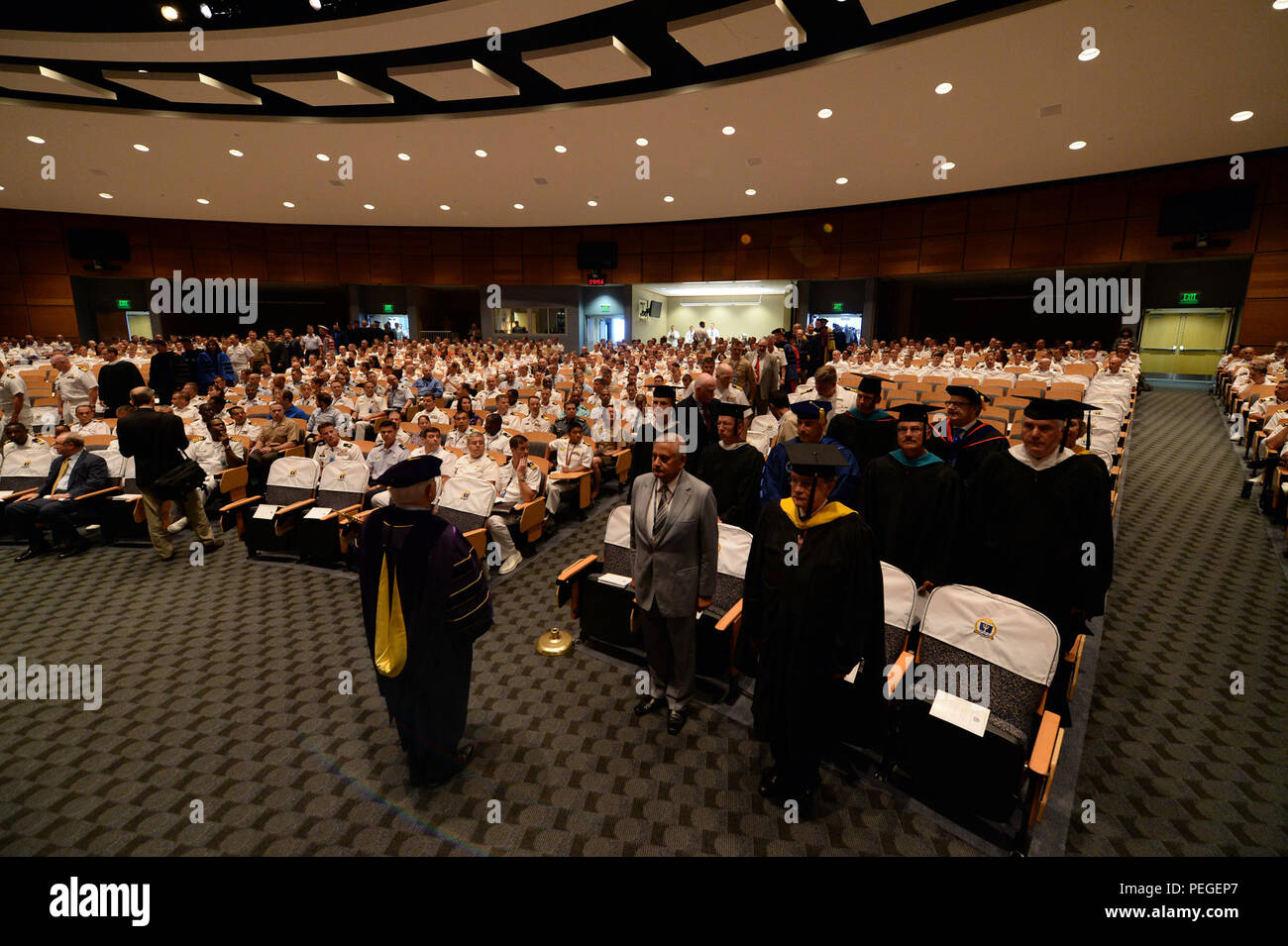Charles Chadbourn, professor for U.S. Naval War College (NWC), leads an academic procession during a convocation ceremony kicking-off the 2015-2016 school year at NWC in Newport, Rhode Island. During the ceremony, Rear Adm. P. Gardner Howe III, president, NWC, presented Adm. Michael S. Rogers, commander, U.S. Cyber Command, director, National Security Agency, chief, Central Security Service, the 2015 Distinguished Graduate Leadership Award. The award honors NWC graduates who have earned positions of prominence in the national defense field. (U.S. Navy photo by Chief Mass Communication Speciali - Stock Image