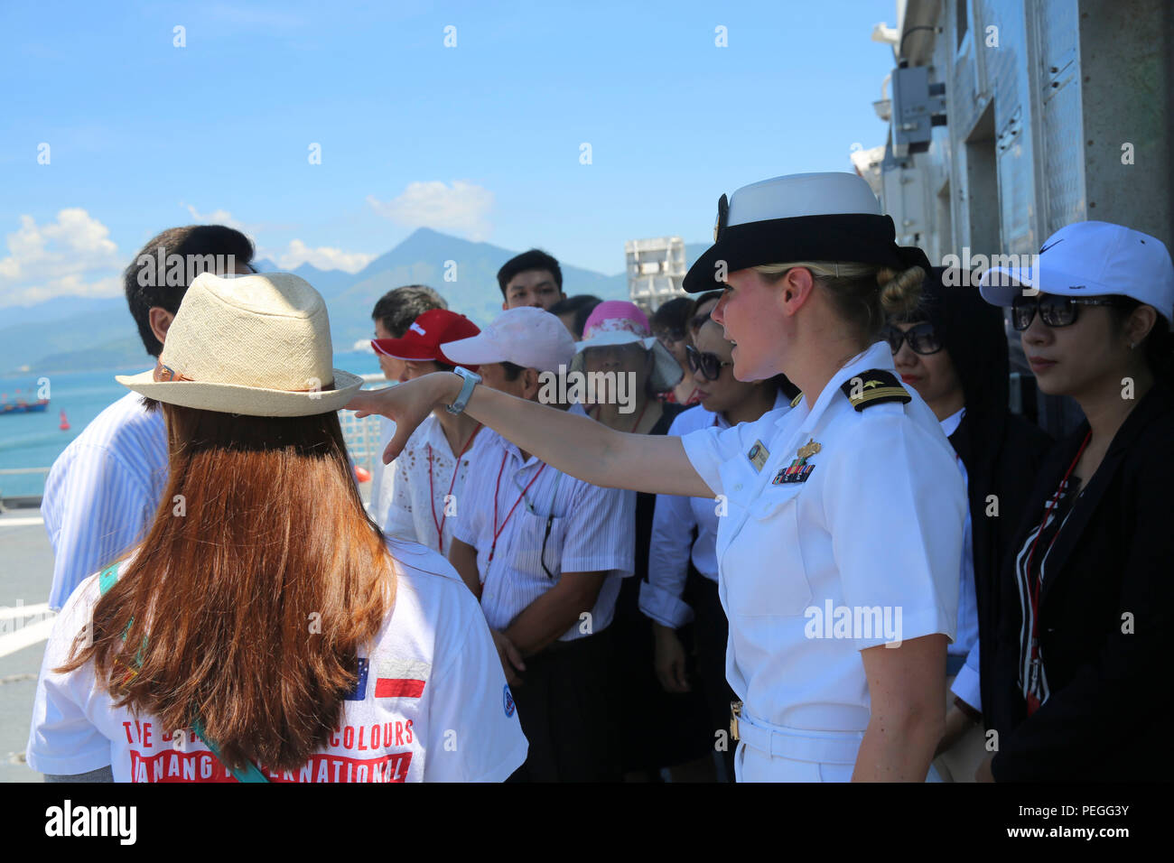 150820-M-GO800-056 DA NANG, Vietnam (Aug. 20, 2015) – Lt. Chelsea Irish explains to local Vietnamese officials the function of the flight deck aboard the Military Sealift Command joint high speed vessel USNS Millinocket (JHSV 3) during a ship tour Aug. 20. Task Force Forager, embarked aboard the Millinocket  is serving as the secondary platform for Pacific Partnership, led by an expeditionary command element from the Navy's 30th Naval Construction Regiment (30 NCR) from Port Hueneme, Calif. Now in its 10th iteration, Pacific Partnership is the largest annual multilateral humanitarian assistanc - Stock Image