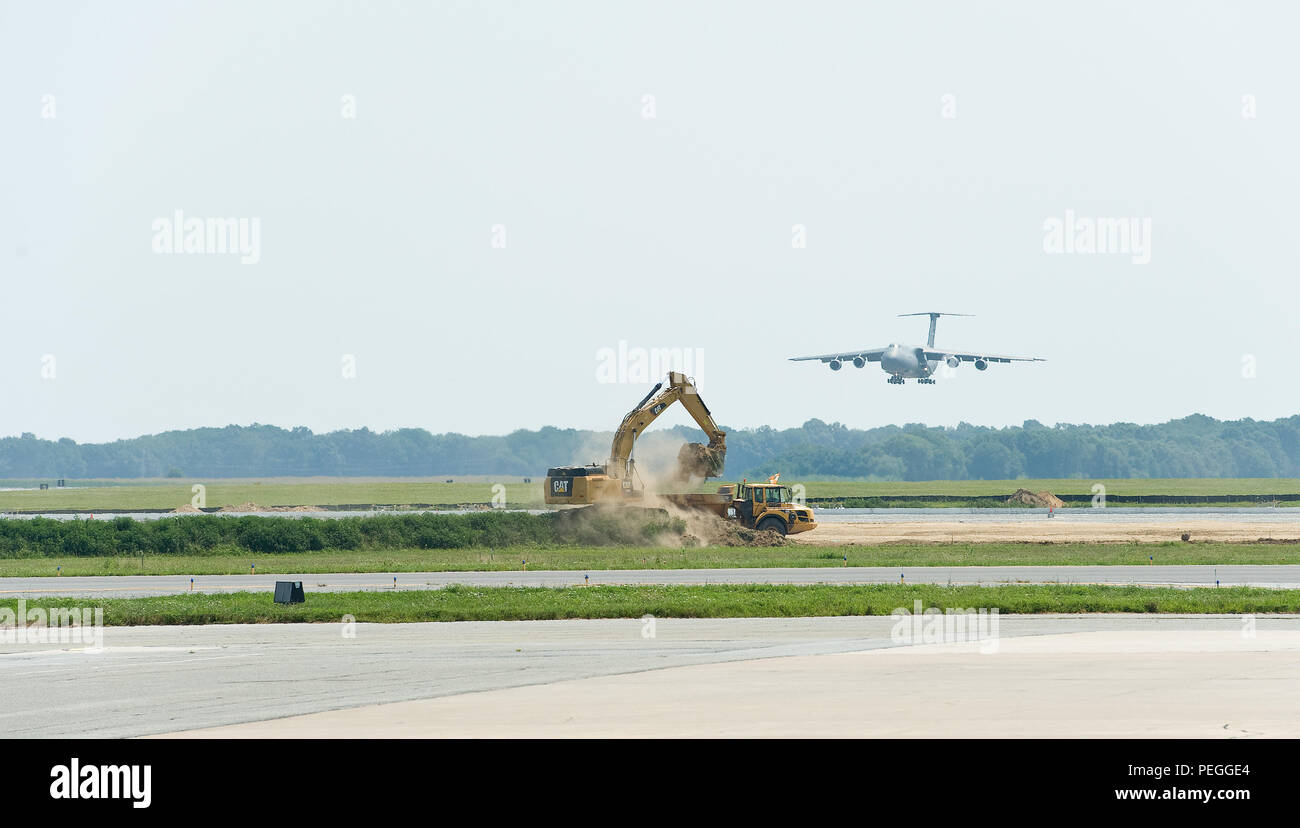A C-5M Super Galaxy approaches the runway for a touch and go landing during a local training flight Aug. 17, 2015, at Dover Air Force Base, Del. Aircraft are able to utilize one runway while a major construction project is taking place on the other runway and various taxiways. (U.S. Air Force photo/Roland Balik) Stock Photo