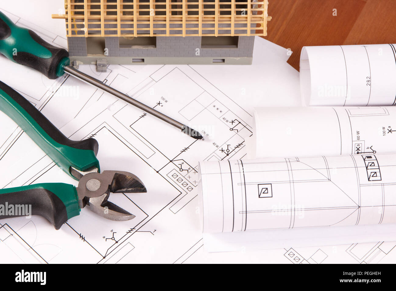 Electrical Drawings Or Diagrams Work Tools And House Under Diagram Building Construction Lying On Desk Home Concept