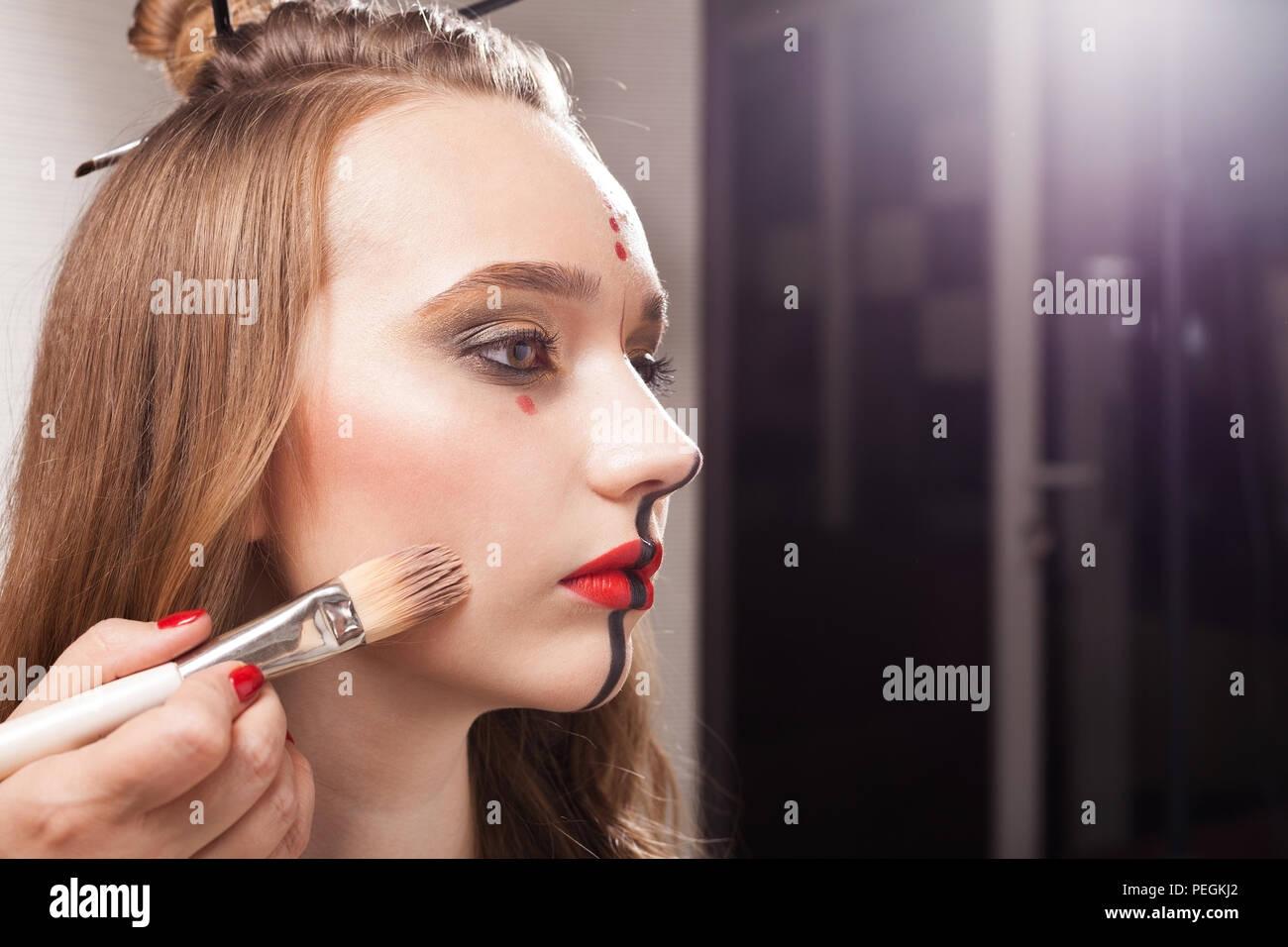 Make Up Woman Applying Foundation On A Model Stock Photo Alamy