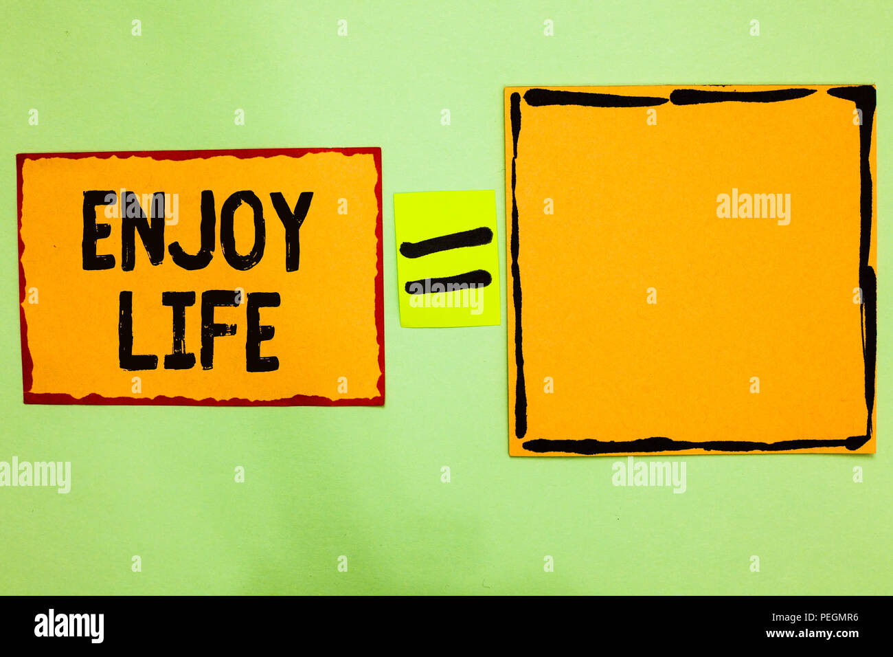 Writing note showing Enjoy Life. Business photo showcasing Any thing, place,food or person, that makes you relax and happy Orange paper notes reminder - Stock Image