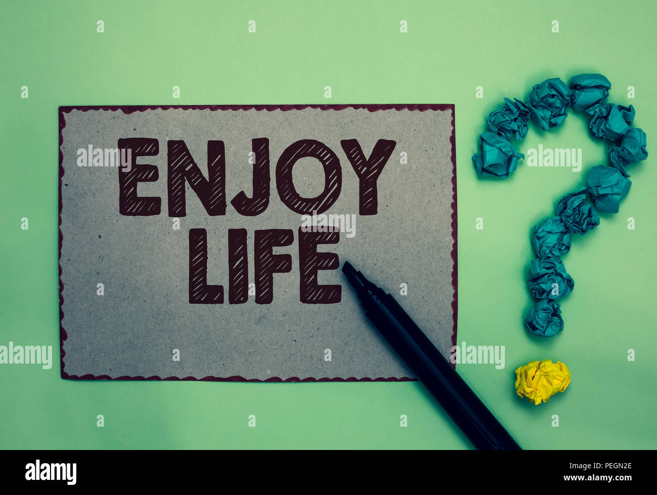 Word writing text Enjoy Life. Business concept for Any thing, place,food or person, that makes you relax and happy Gray paper marker crumpled papers f - Stock Image