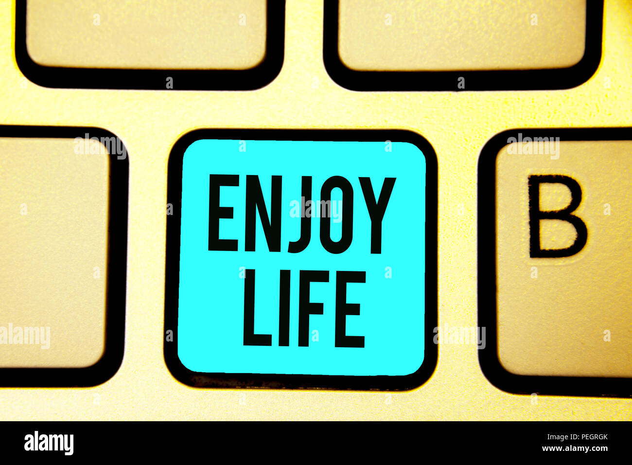 Conceptual hand writing showing Enjoy Life. Business photo showcasing Any thing, place,food or person, that makes you relax and happy Keyboard blue ke - Stock Image