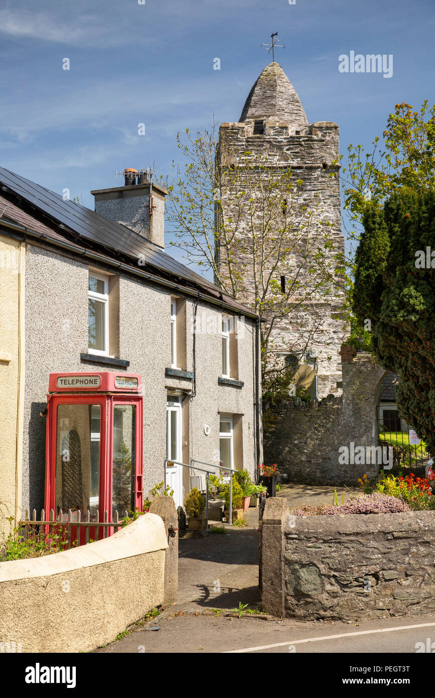 UK, Wales, Anglesey, Llanfechell, old K8 phone box by St Mechell's church with unusual spire to tower - Stock Image