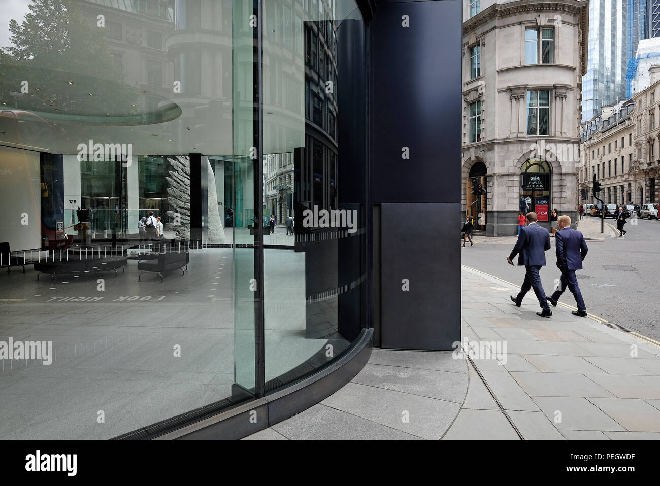 office workers walking in threadneedle street area, central london, england - Stock Image
