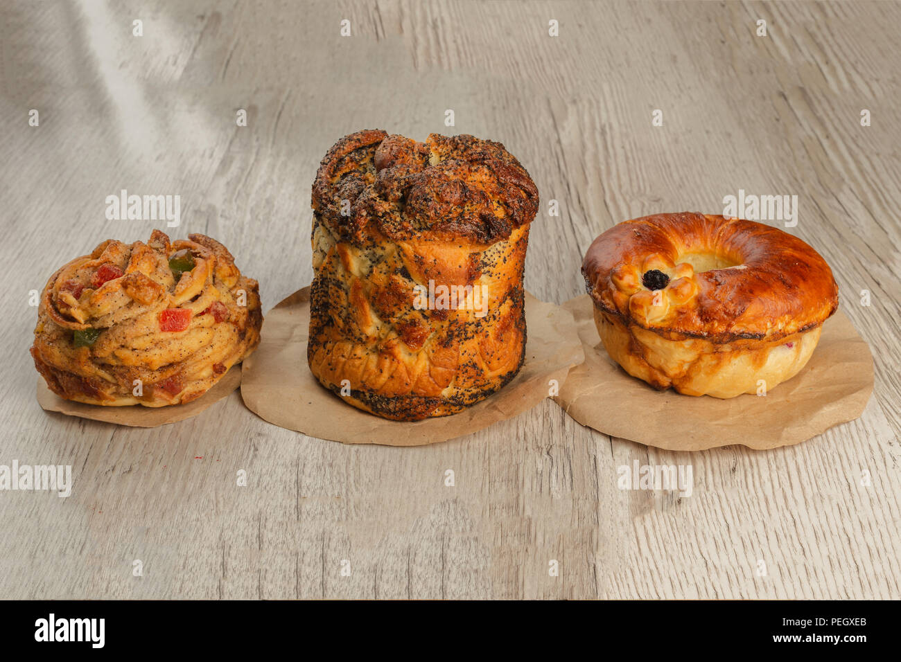 Three different pies on a wooden background. Stock Photo