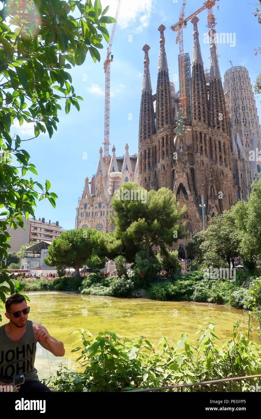 Sagrada Familia by Gaudi. Barcelona, Spain. Hot summer day August 2018. - Stock Image