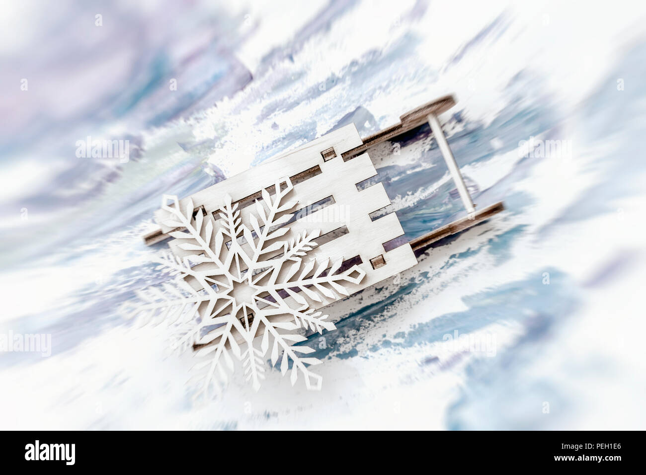 abstract blurred festive christmas background wooden decoration snowflake on little wooden sled - Wooden Sled Decoration Christmas