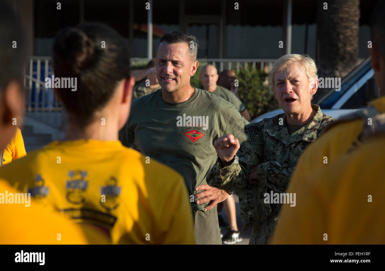 U.S. Marine Corps Maj. Gen. Michael Rocco (left), the commanding general of 3d Marine Aircraft Wing, and Navy Vice Adm. Nora Tyson, the Third Fleet Command Vice Admiral, give their remarks to the I Marine Expeditionary Force and Marine Corps Base Camp Pendleton Hospital Chief Petty Officer Selectees after a run aboard Marine Corps Air Station Miramar, San Diego, Calif., Aug. 27, 2015. The run was conducted to build camaraderie and receive mentorship and guidance from the 3d MAW commanding general and assistant wing commander. (U.S. Marine Corps photo by Lance Cpl. Trever Statz/Released) - Stock Image