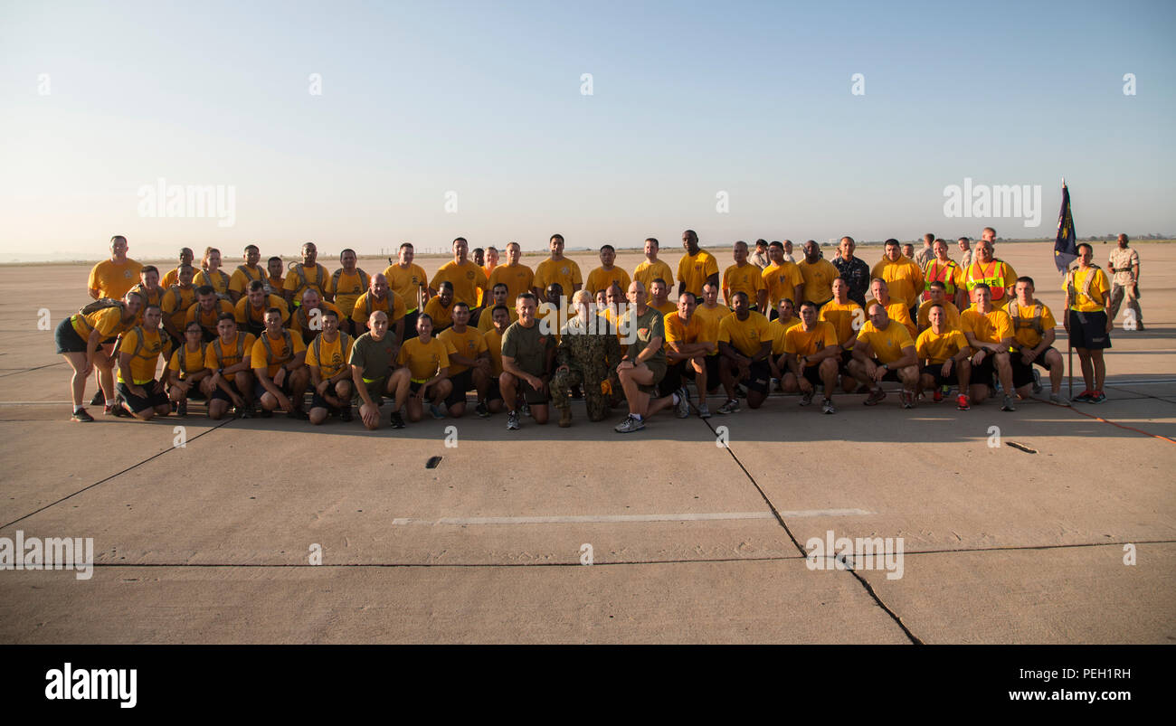 U.S. Navy Vice Adm. Nora Tyson (center), the Third Fleet Command Vice Admiral, and U.S. Marine Corps Maj. Gen. Michael Rocco, the commanding general of 3d Marine Aircraft Wing, pose for a group photo with the chief petty officer selectees of I Marine Expeditionary Force (MEF) and Marine Corps Base Camp Pendleton Hospital after a run aboard Marine Corps Air Station Miramar, San Diego, Calif., Aug. 27, 2015. The run was conducted to build camaraderie and receive mentorship and guidance from the 3d MAW commanding general and assistant wing commander. (U.S. Marine Corps photo by Lance Cpl. Trever  - Stock Image