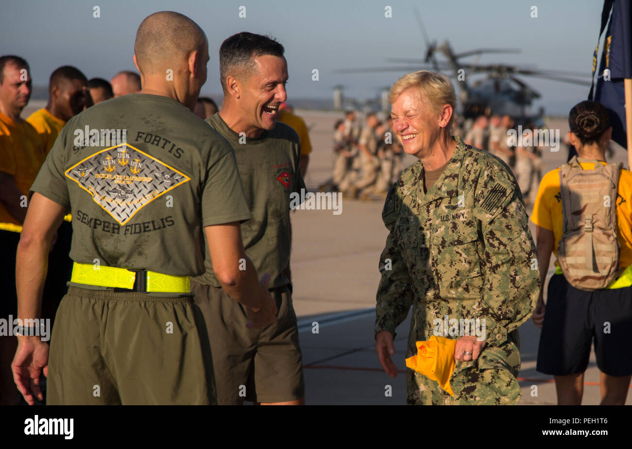 U.S. Navy Command Master Chief Petty Officer Frank Dominguez (left), the command master chief of 3d Marine Aircraft Wing (MAW), Marine Corps Maj. Gen. Michael Rocco, the commanding general of 3d MAW, and Vice Adm. Nora Tyson, the Third Fleet Command Vice Admiral, talk after a run with all I Marine Expeditionary Force and Marine Corps Base Camp Pendleton Hospital Chief Petty Officer Selectees aboard Marine Corps Air Station Miramar, San Diego, Calif., Aug. 27, 2015. The run was conducted to build camaraderie and receive mentorship and guidance from the 3d MAW commanding general and assistant wi - Stock Image