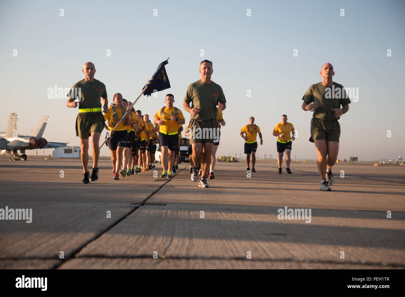 U.S. Navy Command Master Chief Petty Officer Frank Dominguez (left), the command master chief of 3d Marine Aircraft Wing (MAW), Marine Corps Maj. Gen. Michael Rocco, the commanding general of 3d MAW, and Brig. Gen. Kevin Iiams, the assistant wing commander of 3d MAW, participate in a run with all I Marine Expeditionary Force and Marine Corps Base Camp Pendleton Hospital Chief Petty Officer Selectees aboard Marine Corps Air Station Miramar, San Diego, Calif., Aug. 27, 2015. The run was conducted to build camaraderie and receive mentorship and guidance from the 3d MAW commanding general and assi - Stock Image