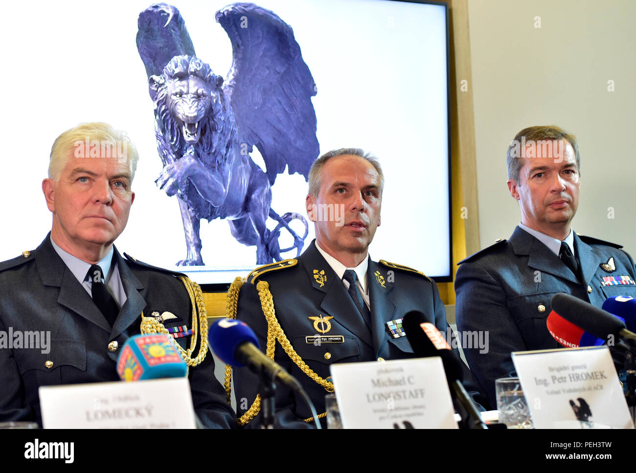 Prague, Czech Republic. 14th Aug, 2018. Military attacha of the British Embassy Michael LongStaff (left), Czech Air Force Commander Petr Hromek (center) and RAF Air Vice Marshal David Cooper (right) speak during a press conference within a meeting marking the upcoming 100th anniversary of the birth of the Czechoslovak air force and commemorating heroism of its WWII pilots took place in Prague, Czech Republic, on August 18, 2018, attended by Czech politicians and representatives of the military, NATO and the British RAF. Credit: Roman Vondrous/CTK Photo/Alamy Live News - Stock Image
