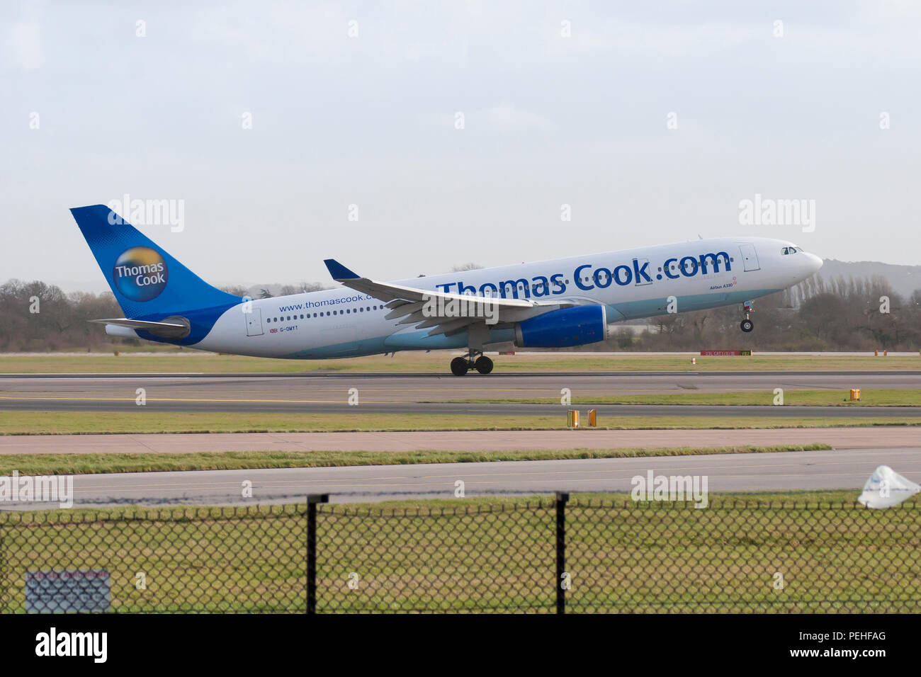 Thomas Cook Airbus A330 in old livery taking off from Manchester Airport - Stock Image