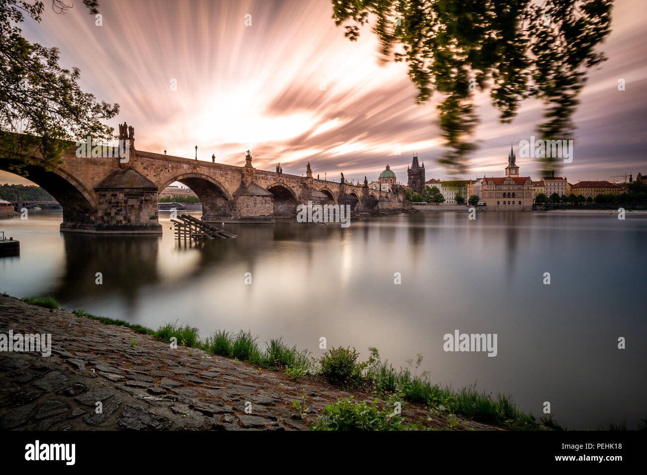 View of Charles Bridge from Kampa with long exposure, Prague - Stock Image
