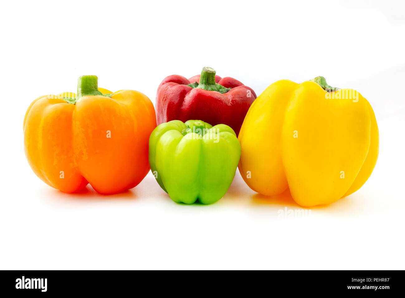 Mixed bell peppers (Capsicum annuum) on a white background - Stock Image