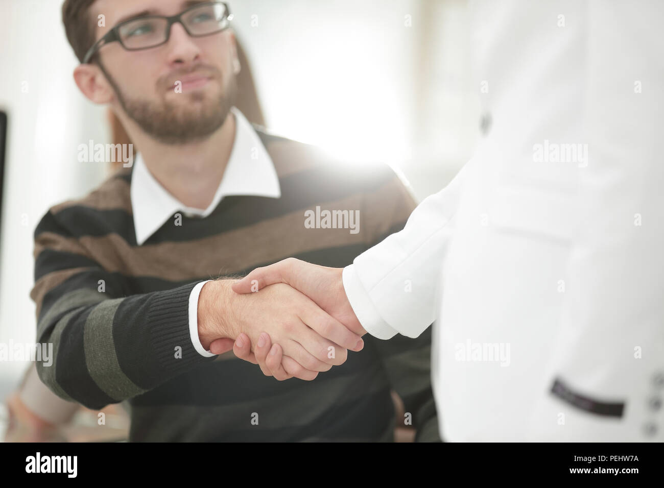 handshake Manager and client in the office. - Stock Image