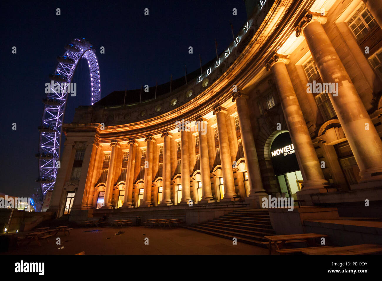 County Hall and London Eye at Night. - Stock Image