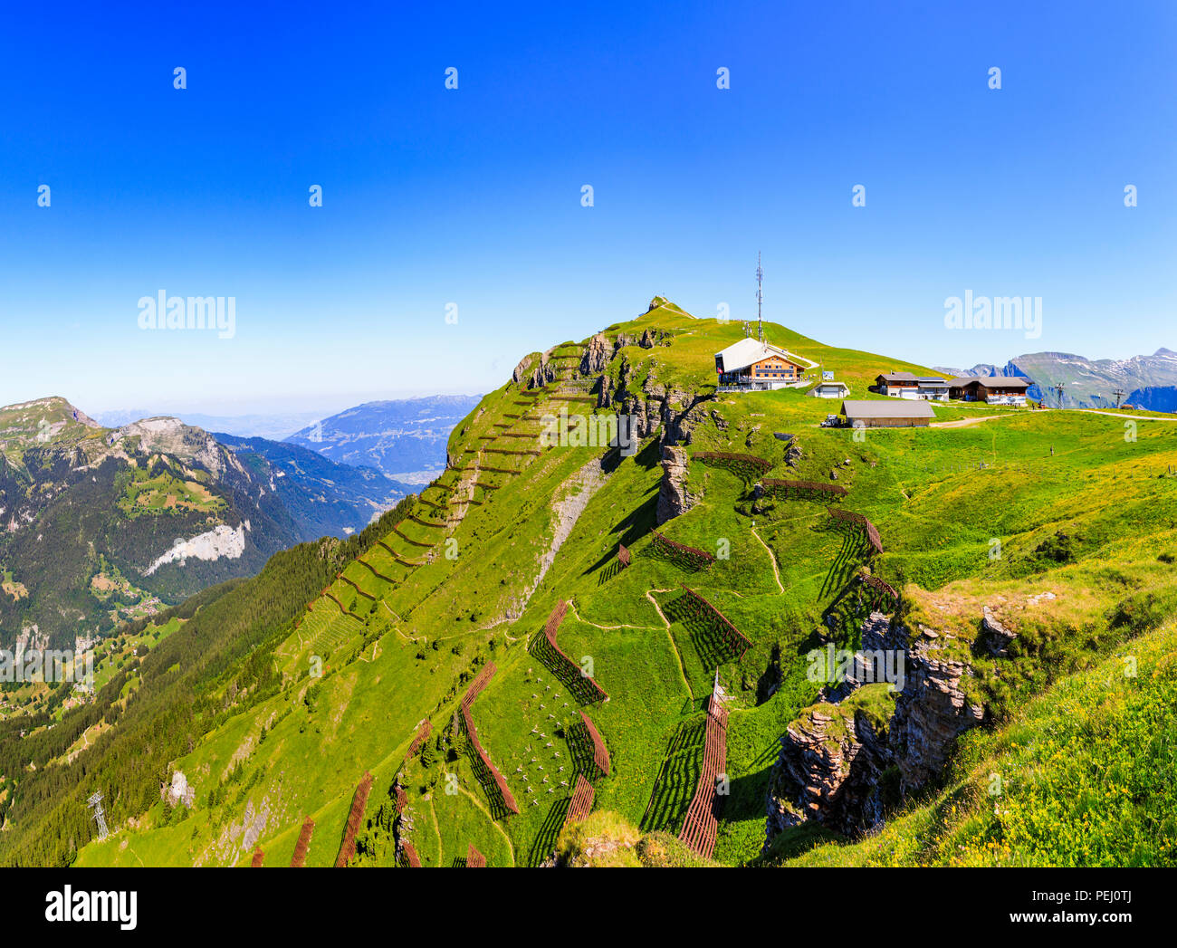Maennlichen cable car station above Wengen and the Lauterbrunnen Valley, Jungfrau region and path to the Royal View, Bernese Oberland, Switzerland - Stock Image