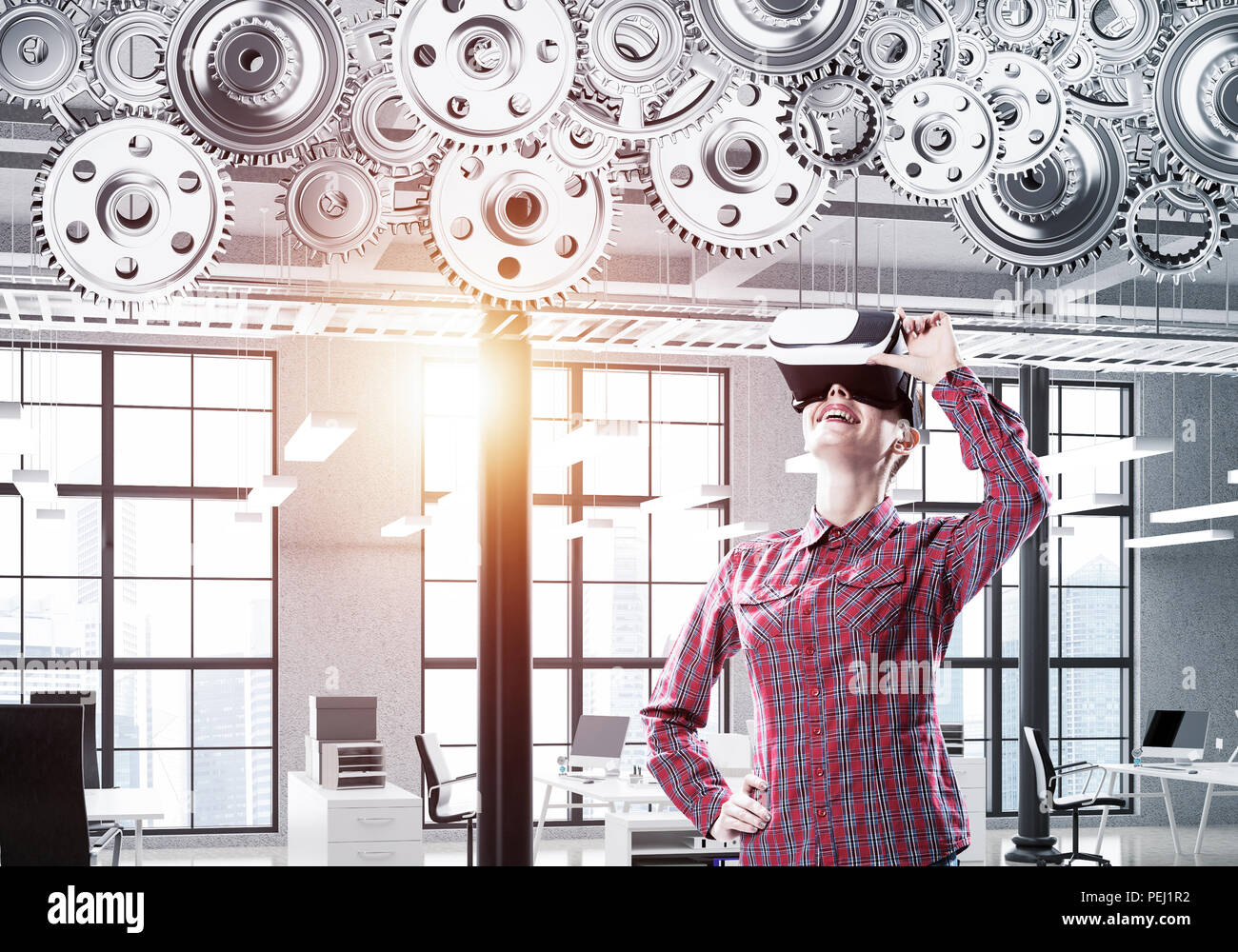 Girl in casual wearing VR glasses and experiencing virtual reali Stock Photo