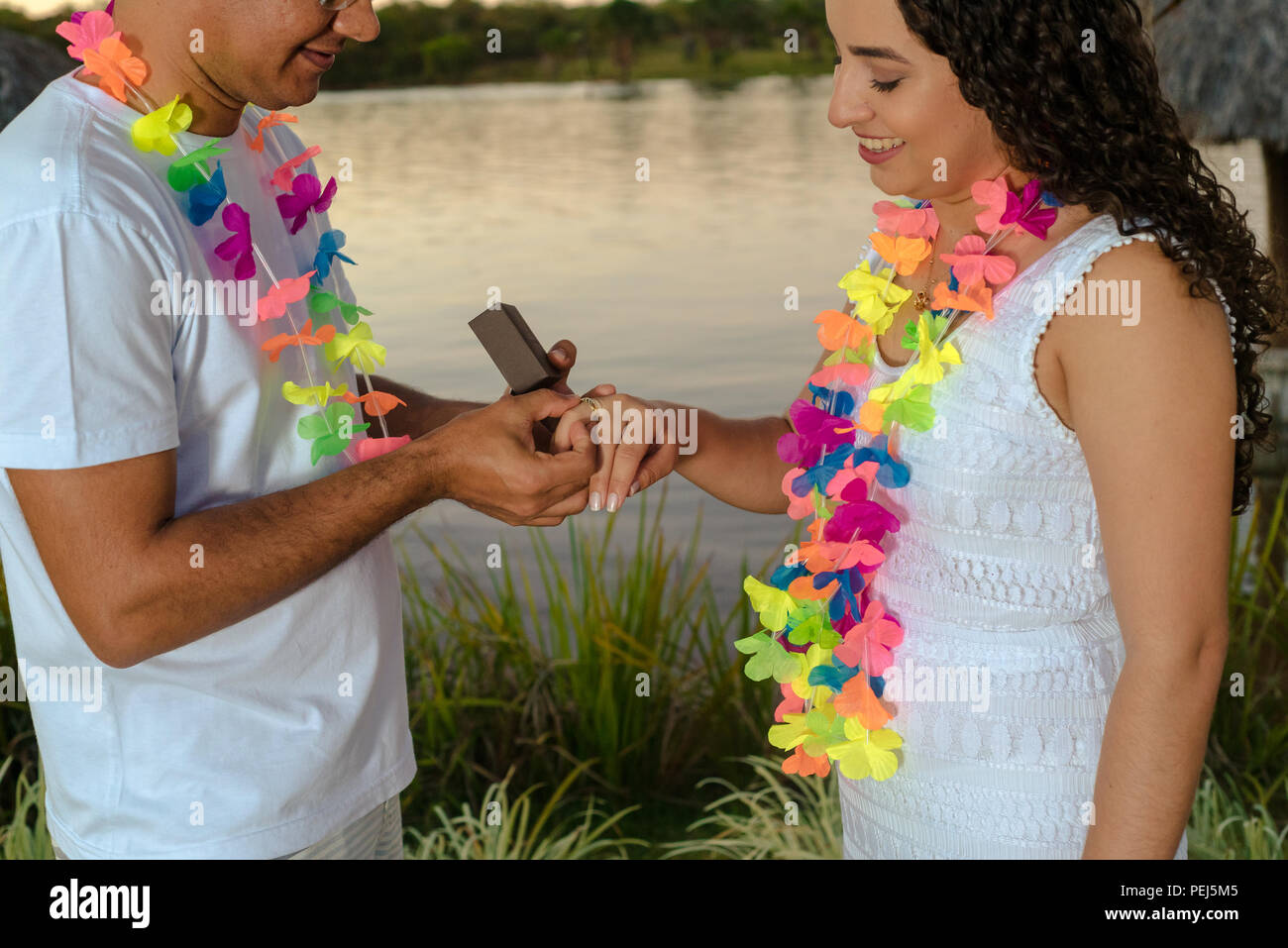 Passionate and happy couple after accepting marriage, Various poses and interactions of this new couple - Stock Image