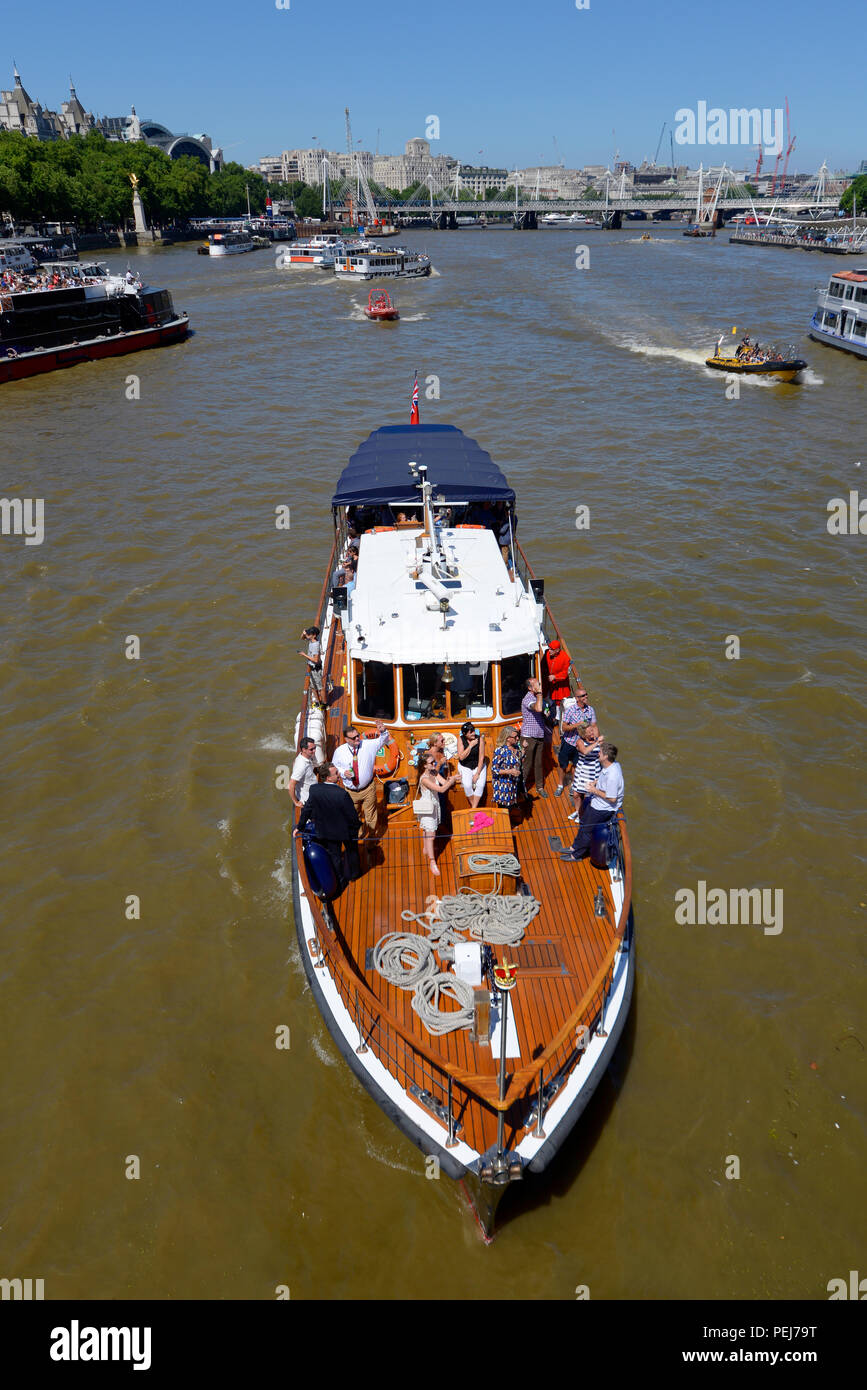 Havengore launch on the River Thames, London, UK, with people during the Thames Historic Barge Race. Known for carrying the body of Winston Churchill - Stock Image