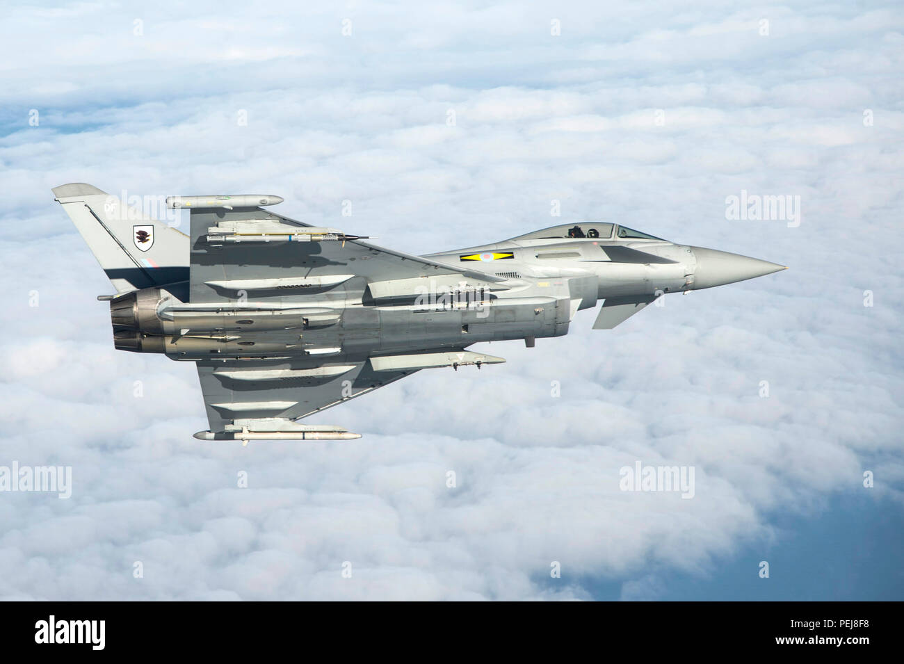 A British Royal Air Force Typhoon flies as part of the inaugural Trilateral Exercise held at Langley Air Force Base, Va., Dec. 7, 2015. The Typhoon provides the RAF with a highly capable agile multi-role combat aircraft, capable of being deployed in full air operations, such as air policing, peace support and high intensity conflict. (U.S. Air Force photo by Senior Airman Kayla Newman) - Stock Image