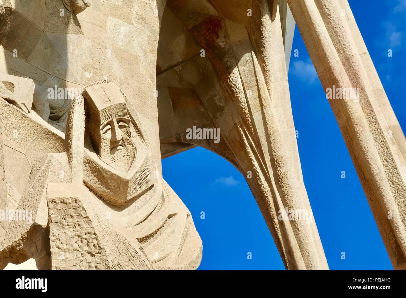 Sad man sculpture at the Sagrada Familia by Gaudi. Barcelona, Spain. Hot summer day August 2018. - Stock Image