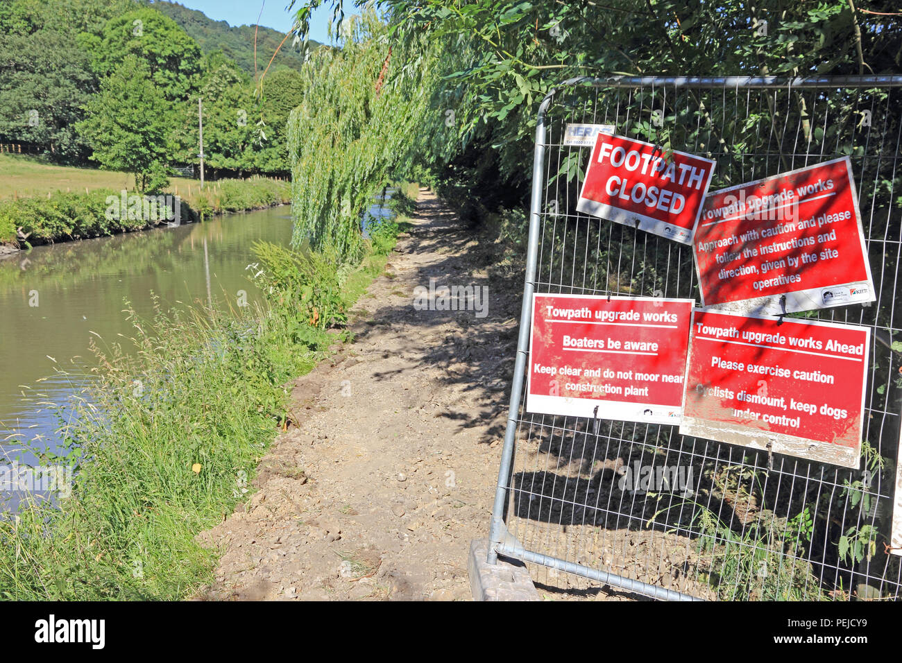 Canal towpath closed signs, to allow improvements to towpath surface - Stock Image