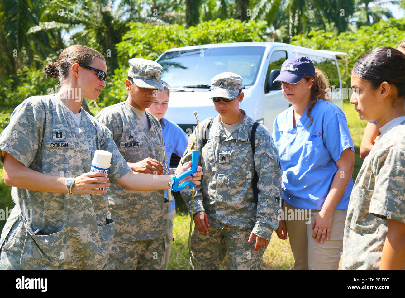 150830-A-ZA034-008 COLON, Honduras (Aug. 30, 2015) Army veterinarians, veterinarian technicians and a volunteer with the non-governmental organization (NGO) World Vets assigned to Military Sealift Command hospital ship USNS Comfort (T-AH 20), review medical equipment at a local farm in support of Continuing Promise 2015 (CP-15). World Vets volunteers are working alongside other NGOs and military members during CP-15. Continuing Promise is a U.S. Southern Command-sponsored and U.S. Naval Forces Southern Command/U.S. 4th Fleet-conducted deployment to conduct civil-military operations including h - Stock Image