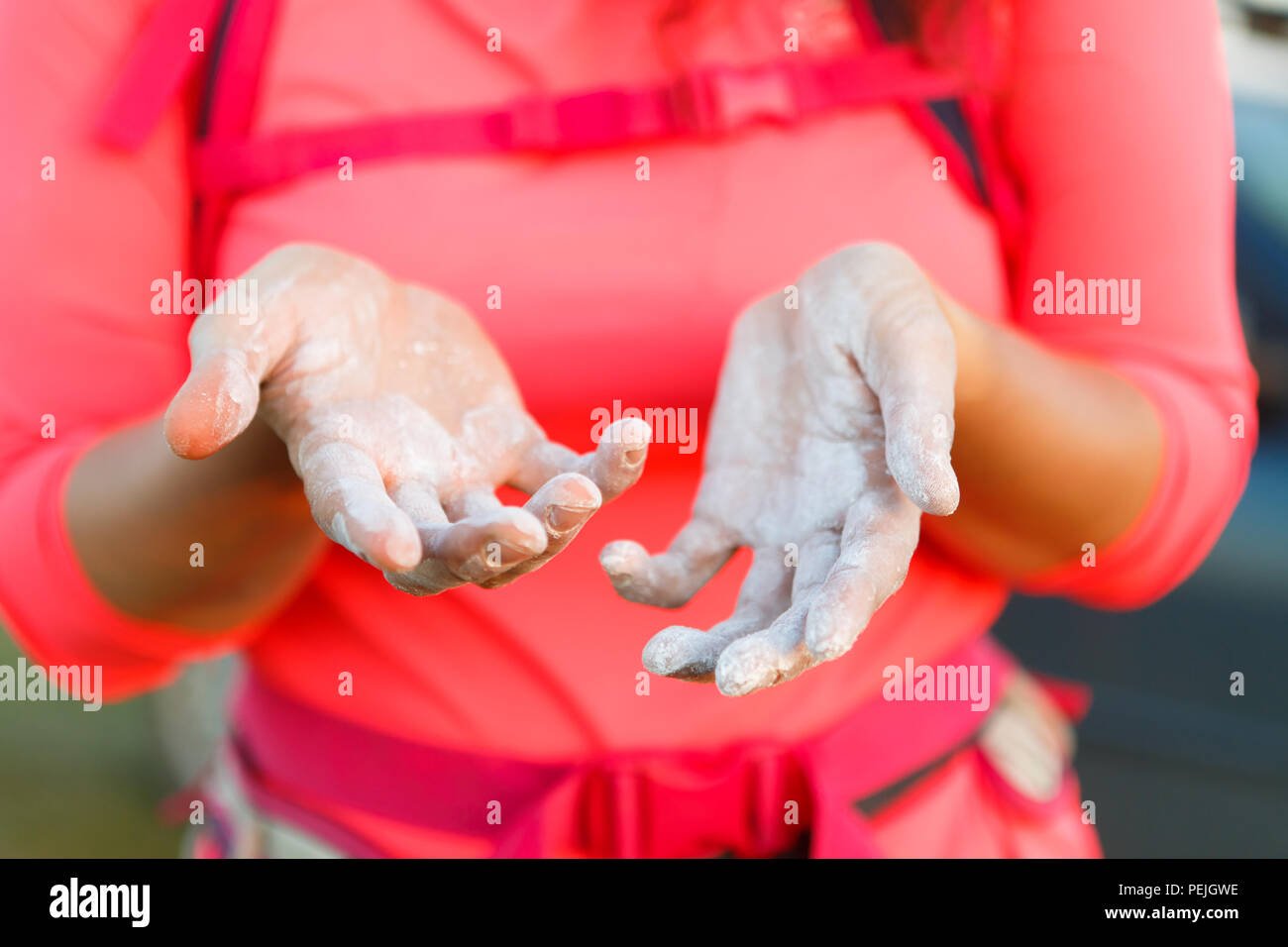 Image of woman climber with talc on hands - Stock Image