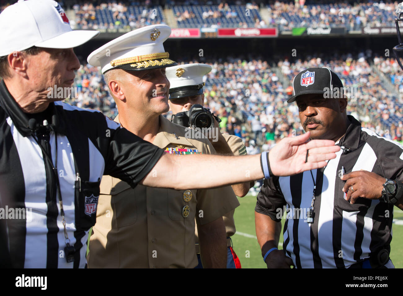 Maj. Gen. Michael Rocco, commanding general of the 3rd Marine Aircraft Wing, watches the decision of the coin toss prior to the game between the San Diego Chargers and Seattle Seahawks in Chargers Stadium, San Diego, Aug. 29. Marines stationed aboard MCAS Miramar participated in the opening ceremony prior to the game between San Diego Chargers and Seattle Seahawks. (U.S. Marine Corps photo by Sgt. Lillian Stephens/Released) - Stock Image